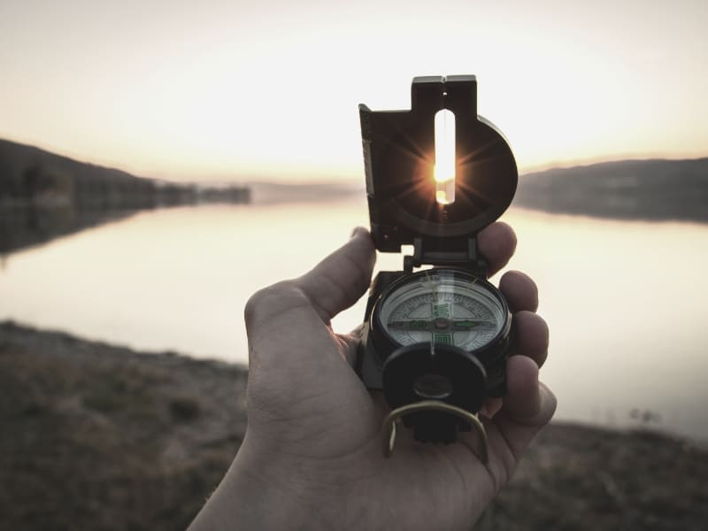 compass against sunset