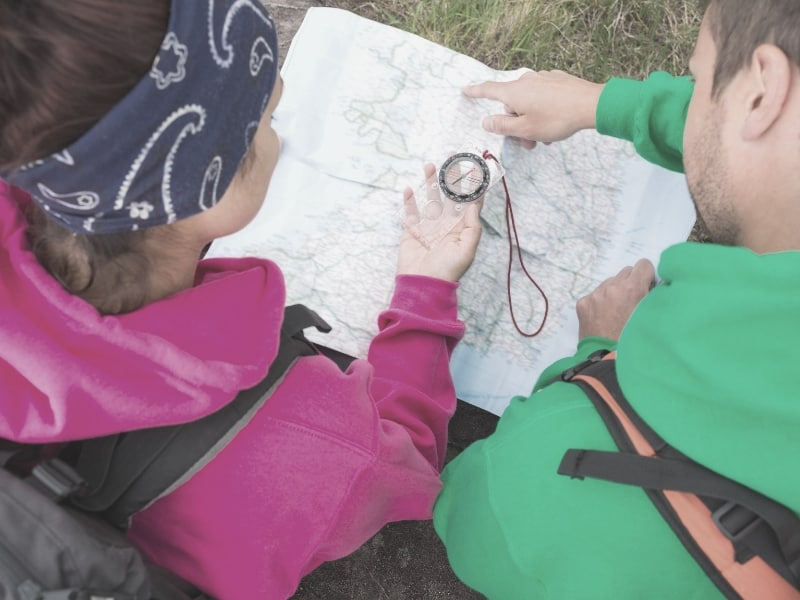 hikers with map and compass