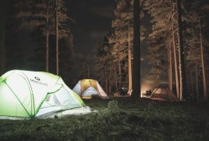 Several Tents in forest at night_featimage