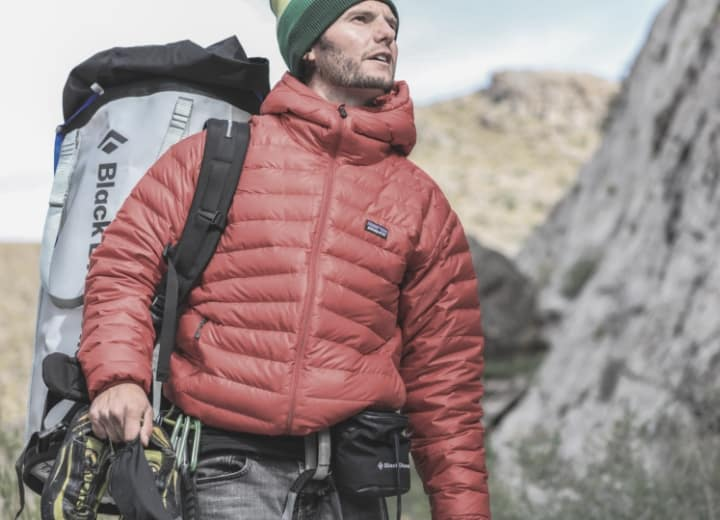 Climber in winter gear with backpack