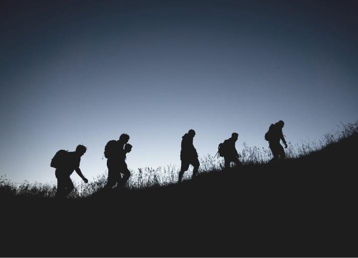 Hikers silhouette night hiking