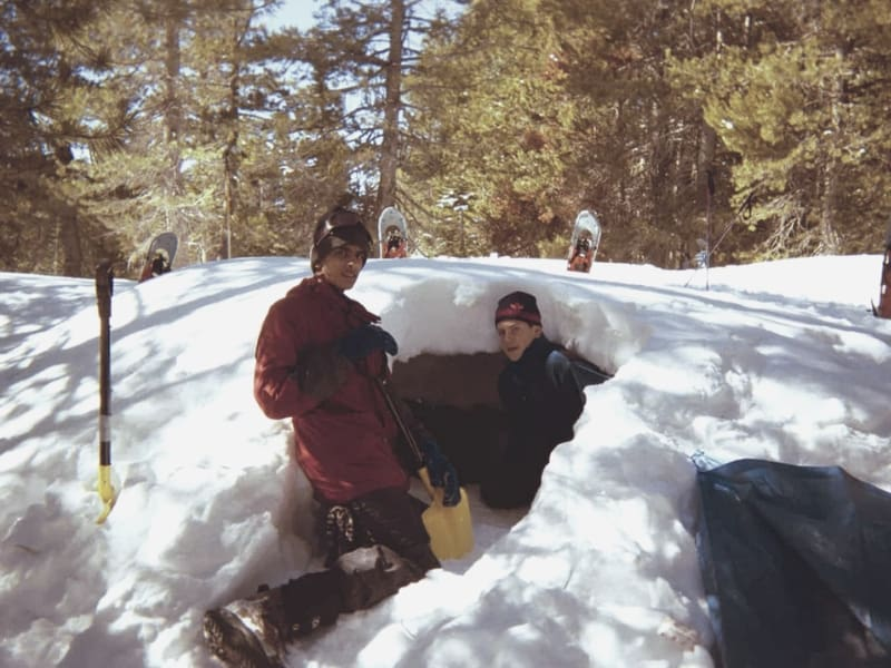 Backpackers Building Snow Cave