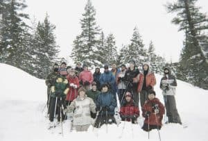 Group of Backpackers Snow Hiking