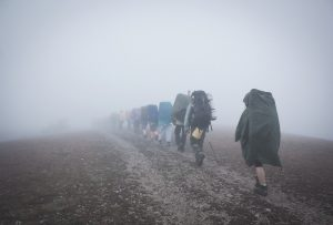 backpackers in rain wearing ponchos