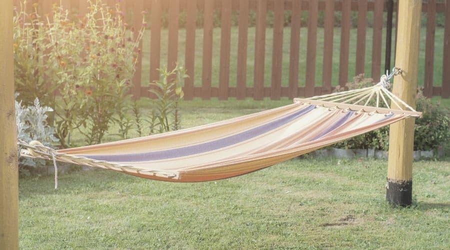 hammock hanging on poles in backyard