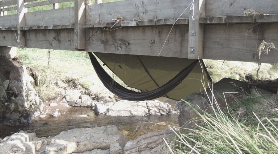 hammock pitched under bridge