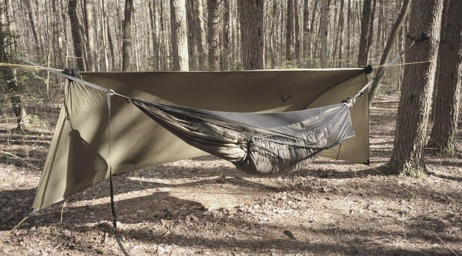 hammock pitched with underquilt rain tarp and bug net