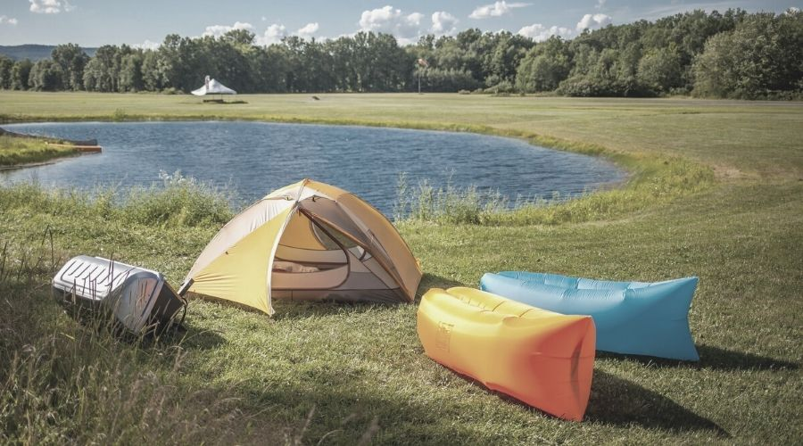 two outdoor inflatable loungers and a tent